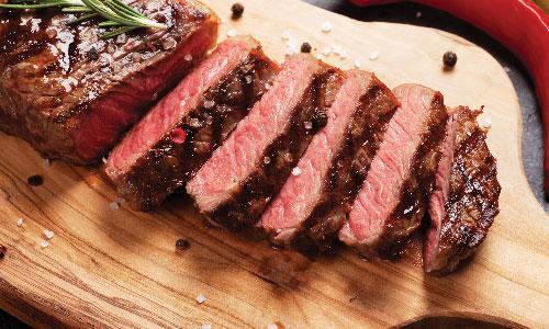 Buy One, Get One FREE NY Strip Steaks or Boneless Rib Eye Steaks at Hazel Park Food Center