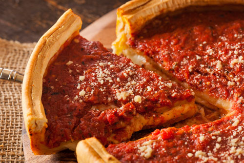 """$14.99 """"Chicago Style"""" Deep Dish Round Pizza at Holiday Pizza & Chuck's Catering"""