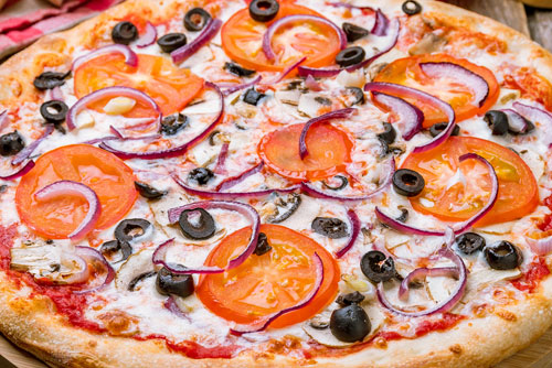 $2 OFF Any Large or X-Large Pizza at Holiday Pizza & Chuck's Catering